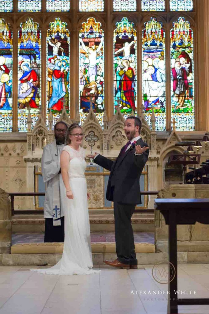 Wedding Bride and Groom at the altar of St Mary's Church in Horsham