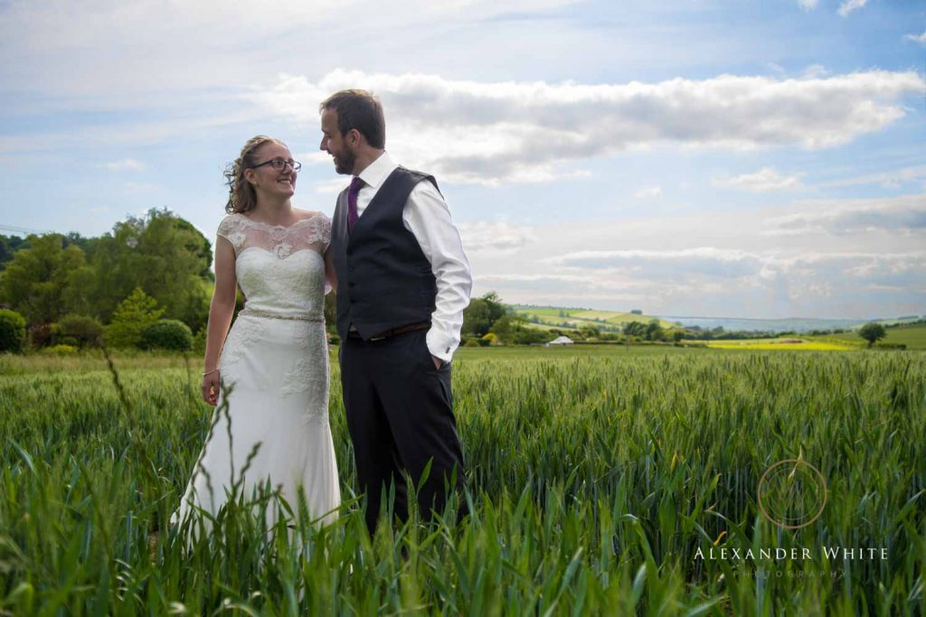 Couple Photo of the Bride and Groom in a field
