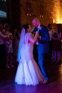 Wedding photo of the couple doing their first dance